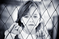 Trapped (Tiag Ribeiro) Tags: portrait bw girl beautiful beauty angel fence hair eyes nails lara