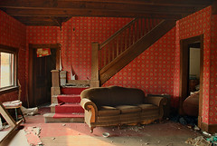 Rogers (?) House - great room (heinrick05) Tags: red wallpaper abandoned michigan sofa staircase thompsonville benziecounty