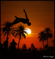 He Can Fly, If He Just Believes ! (Bashar Shglila) Tags: sunset sun lake silhouette palms fun jump jumping diving libya  ain ghadames  libyen  lbia  libi libiya anawesomeshot liviya libija       lbija  lby libja lbya liiba livi   elfaras