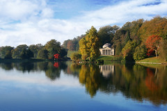 Autumn at Stourhead (sminky_pinky100 (In and Out)) Tags: uk blue autumn red england lake green heritage yellow clouds reflections pretty vivid historical colourful wiltshire nationaltrust stourheadgardens abigfave henryhoare omot arttouch