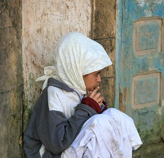 Portrait of a Moroccan Girl (Alex E. Proimos) Tags: africa cute girl beauty photography hope gold photo hands sitting child hand sad searchthebest gorgeous islam pray praying young award down pic morocco together sit thinking despair donation prize wish distillery soe essaouira prayers winning moroccan islamic squatting wishing mogador funds mywinners abigfave flickraward proimos alexproimos