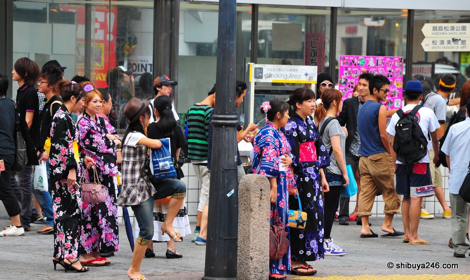 Plenty of girls wearing Yukata at the moment. Probably they are on the way to a fireworks display