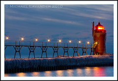 South Haven South Pier (Michael Lavander) Tags: winter usa lighthouse snow cold ice canon evening pier dusk michigan lakemichigan greatlakes blackriver southhaven southpier 70200f28l canon40d february2010 michaellavander httpmlavcom 262010