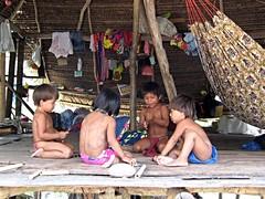 Embera children playing in a hut, Panama (ali eminov) Tags: children brothersandsisters emberachildren childrenoftheworld childrenatplay huts houses hammocks katuma panama emberaindians