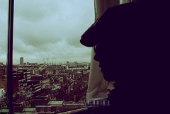 Behind The Window.. (- M7D . S h R a T y) Tags: uk sky london window silhouette skyscraper dark view cloudy unitedkingdom wordsbyme london2010 allrightsreserved