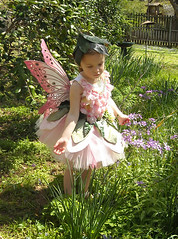 A Fairy in Our Garden (On Gossamer Wings) Tags: pink flowers wedding portrait halloween children petals costume child wing recital fairy flowergirl custom making tutu fairycostume fairywings faeriewings photographyprop faerywings fairyhat leafhat ongossamerwings fairyset childrensfairywings cotumefairywings