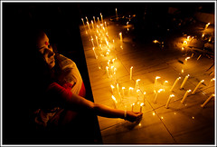Light a candle of hope [..Dhaka, Bangladesh..] (Catch the dream) Tags: lighting light woman face festival religious temple hope shrine candles darkness bongo sparkle devotion candlelight dhaka reverence diwali devotee bengal bangladesh ramna gettyimagesbangladeshq2