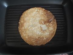 Place one pancake in heated pan