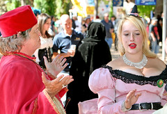 Animated Converstion (wyojones) Tags: pink red woman man girl beautiful beauty necklace belt eyes hands catholic texas dress cardinal princess trf teen cap blond blonde kelly conversation priest renfaire cloth renaissancefestival talking bishop renaissance renaissancefaire renfest maiden rennie damsel witcheshat talkingwithhands texasrenfest texasrenaissancefestival plantersville frenchcourt toddmission wyojones francoisedufoix