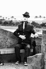sit down (Cani Mancebo) Tags: white man black hat glasses invisible tie suit gloves sentado corbata gafas sombrero traje guantes sitdown siéntate canimancebo