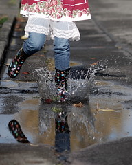 splashing in puddles (lydiafairy) Tags: road street selfportrait reflection me water sunshine rain vintage myself fun puddle interestingness nikon colorful bright explore splash wellies playful rubberboots mudpuddle spt splish splashing 105mm explored d80