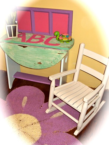 Antique child's drop-leaf table, wooden rocking chair and painted jute rug