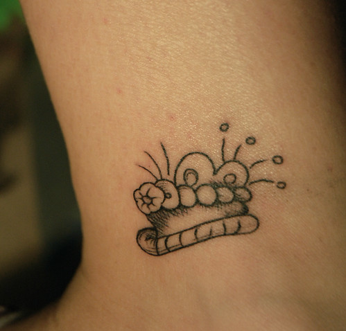 Ankle rosary tattoo.