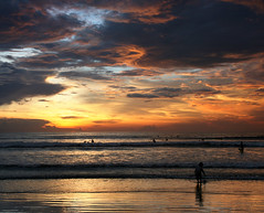 A sunset in Bali (Chee Seong) Tags: sunset bali sun beach silhouette clouds canon indonesia sand wave handheld canon1755mm 400d