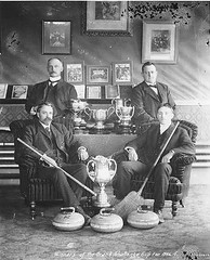 Curling team sitting around trophies, Dawson, Yukon Territory (UW Digital Collections) Tags: canada sports trophy trophies 1906 dawson curling yukonterritory curlingstones edwardadams edwardcadams grandchallengecup
