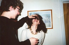 curly teeth (Adele M. Reed) Tags: party smile hair gold chain pete loz nikonl35af kodakhd200