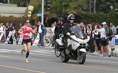 Erika Aklufi with police escort (kjdrill) Tags: ocean california street usa streets beach sports sport race start la pier losangeles pacific santamonica marathon running route distance runner dodgerstadium 6096