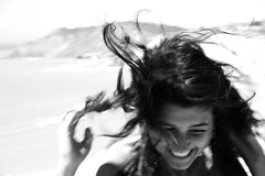 Medusa (prcralexandra) Tags: sea bw girl smile hair wind happiness shore medusa alexandrapurcaru howeveritsstillmylife