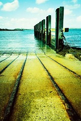 Slipway... (Trapac) Tags: uk blue sea summer sky film clouds gold scotland xpro crossprocessed waiting iron kodak turquoise empty cyan rusty olympus slidefilm xa2 rails pilings harris elitechrome olympusxa2 calmac find slipway berth outerhebrides 100iso carferry kodakelitechrome wmh eb3 isleofharris leverburgh roll14 kodakeb3 naheileanansiar thewesternisles caledonianmacbraynehebrideanclydeferries naheradh harristoberneray gtap1612