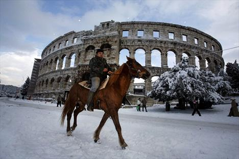 Riding horse in front of Pulas Roman Amphitheater