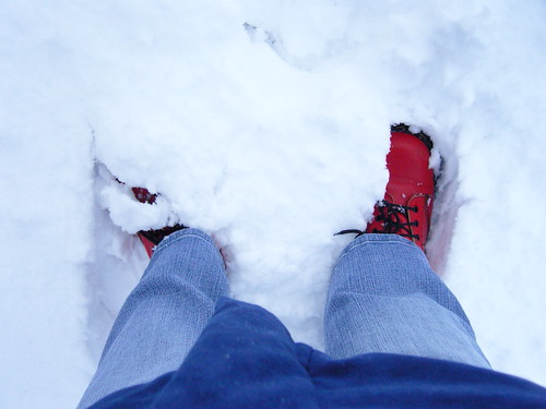 Red boots in white snow