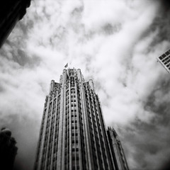 Reach for the sky (Kerrie McSnap) Tags: city sky blackandwhite bw chicago building 120 film architecture clouds mediumformat square illinois holga lomo lomography toycamera kodaktrix400 500x500 kodaktx400