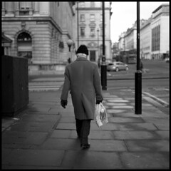 Walking away (ted.kozak) Tags: street bw london 6x6 walking square oldman selfdeveloped fomapan100 kozak mamiyaflexc2 sekor fomafomapan film:iso=100 tedkozak tadaskazakevicius film:brand=foma developer:brand=agfa film:name=fomafomapan100 agfar09oneshot developer:name=agfar09oneshot filmdev:recipe=5599