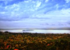 Lake Victoria, Uganda (Irene2005) Tags: africa red sky lake beautiful clouds 35mm peaceful calm roofs uganda lakevictoria f20 viewfromthehill primelens munyonyo nikond90 closetokampala