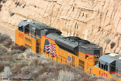 Through the Canyon (El Roco Photography) Tags: california railroad santafe up train canon rail trains socal transportation unionpacific locomotive ge bnsf cajon railroads sanbernardino freighttrain sanbernardinocalifornia emd atsf burlingtonnorthernsantafe cajonpass es44dc alltrains stacktrain bnsfrailroad burlingtonnorthernsantaferailroad movingtrains elrocophotography