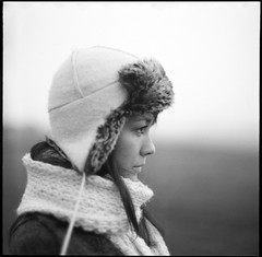 Winter Stare... (vonSchnauzer) Tags: winter blackandwhite bw eye 120 6x6 film girl hat scarf mediumformat asian nose kodak bokeh profile d76 stare eyelash ruskie norita