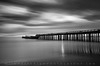 Linear Light - Aptos, California (Jim Patterson Photography) Tags: ocean california longexposure blackandwhite usa santacruz motion beach nature water monochrome clouds coast pier sand pacific shoreline seacliff coastal shore wharf coastline aptos reallyrightstuff cementship gitzotripod statebeach nikkor1224mm graduatedneutraldensityfilter sspaloalto singhray leefilters nikond300 markinsm20ballhead jimpattersonphotography bwnd30 jimpattersonphotographycom seatosummitworkshops seatosummitworkshopscom
