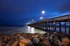 Newport pier (Andy Kennelly) Tags: ocean california blue light beach night lights pier rocks long exposure pacific cloudy rocky newport hour balboa peninsula
