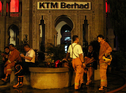 Kuala lumpur 29/10/2009 -- The volunteer  from Bukit Bintang Fire fighter  take a rest after finish the extinguish fire at KTMB Head Quater. The 1st floor and mezzaine (filling) was on fire early this morning.  Pic by OSMAN ADNAN