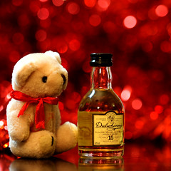 Shock! Horror! Scottish bear paints the town red! (Mukumbura) Tags: bear christmas xmas red mountains water barley table scotland town miniature bottle still paint bokeh scottish peat single horror shock whisky scotch distillery hogmanay malt dalwhinnie 1898 centenary grampian greatnorthroad 15yearold lochanandoirreuaine