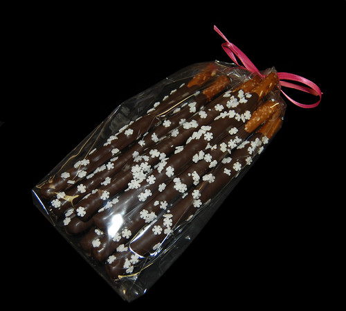 snowflake chocolate dipped pretzels with pink ribbon