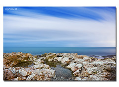 Hadouken (SergioTudela) Tags: longexposure sea sky cloud reflection water sergio rock stone mar spain agua cielo creativecommons reflejo 2009 nube roca mlaga piedra largaexposicin hadouken a900 pendelcuervo sal20f28 sony20mmf28 sonya900 sonyalpha900 sergiotudela sergiotudelacom sergiotudelaphotocom