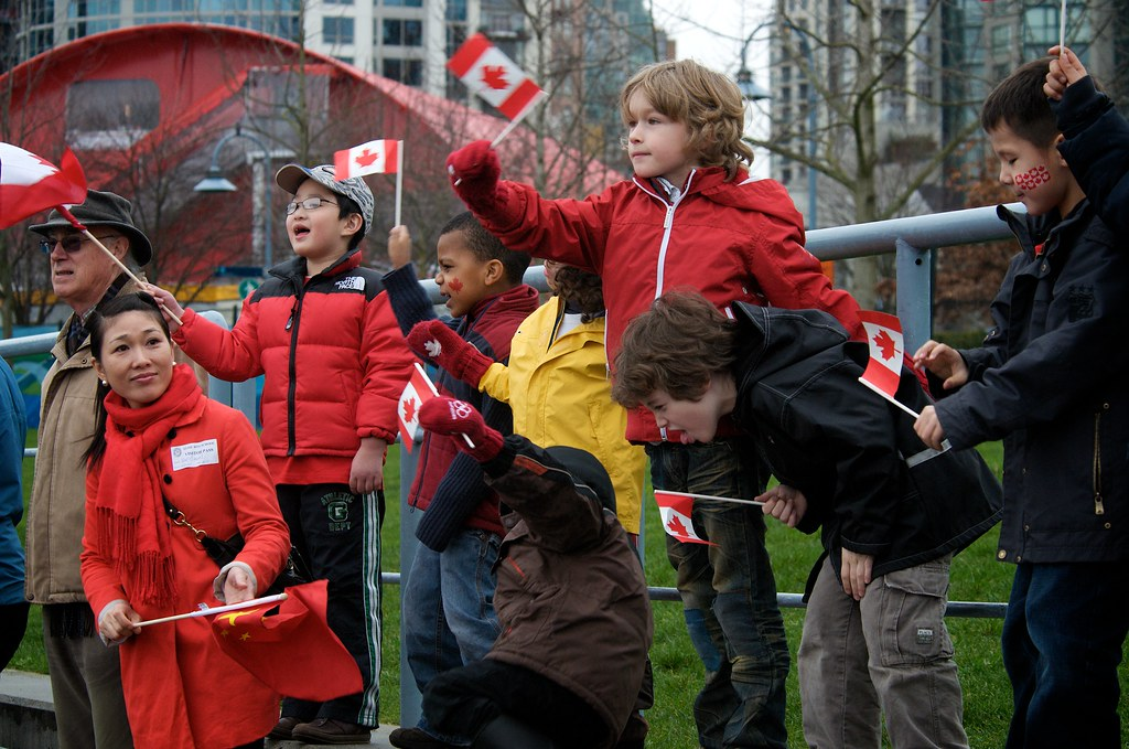 A Group of Kids Cheers on The Olympic Torch