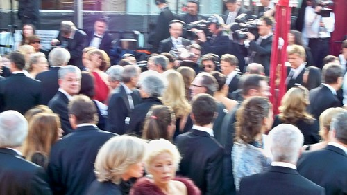A blurry Steve Jobs on the red carpet