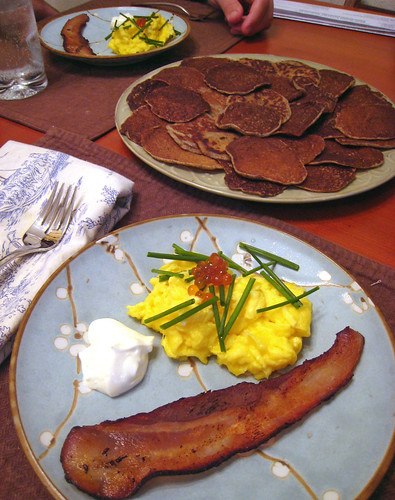 Duck Eggs with Blinis and Bacon.