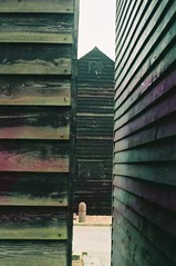 Net shops (melita_dennett) Tags: old uk england net industry film 35mm sussex coast town seaside fishing britain south historic east huts coastal shops hastings analogue fishmarket