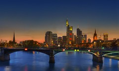 Frankfurt am Main (Wolfgang Staudt) Tags: plaza city blue windows sunset sky skyline clouds skyscraper river germany deutschland evening am big nikon holidays europe photographie sonnenuntergang hessen skyscrapers cloudy frankfurt zimmer main tripod sigma tourist couch hour hotels aussicht reflexions hdr wolfgang hotelroom commerzbank sessel  wolkenkratzer d300 blaue stativ armchairs stunde  hotelzimmer luminale lindner ignazbubisbrcke  golddragon staudt 66111 leinpfad    grouptripod