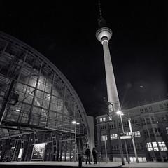 Waiting under the Tower (ucn) Tags: berlin alexanderplatz stadtbahn fernsehturm telespargel televisiontower railroadstation sbahnhof rolleiflexsl66 distagon40mmf4 rolleiortho25 agfarodinal filmdev:recipe=11219 film:brand=rollei film:name=rolleiortho25 film:iso=25 developer:brand=agfa developer:name=agfarodinal