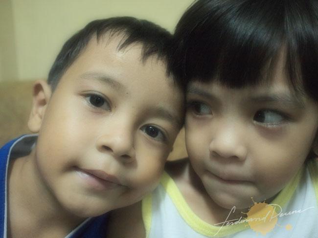 Siblings (Olympus E-P1, ISO 1600, 17mm Pancake, f2.8, 1/25sec, Soft Focus)