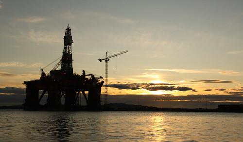 An oil platform in the sunset, taken outside Askøy in Hordaland, Norway.