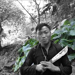 Hmong man shows Hmong knife pride (NaPix -- (Time out)) Tags: portrait man black nature landscape asia bokeh knife pride vietnam jungle sapa hmong napix