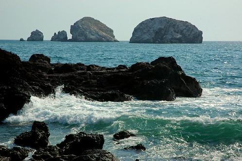 Blue waves on the black rock shore of South Mazatlan, Islands, Sinaloa, Mexico by Wonderlane
