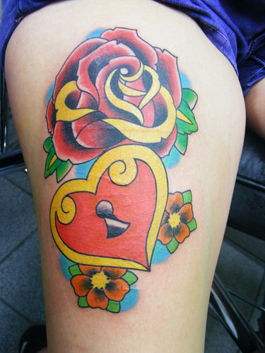 Rose Tattoo and Heart at Woman Body