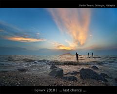 ... last chance ... (liewwk - www.liewwkphoto.com) Tags: ocean sunset sun water set landscape coast seaside sand view salt surface malaysia beast  klang pantai jeram selangor sigma1224     liewwk