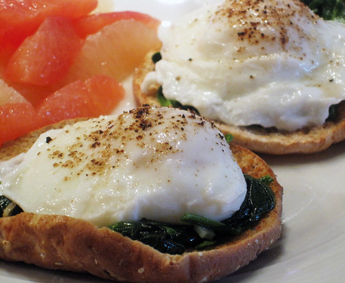 Poached Eggs Over Sauteed Garlic Spinach