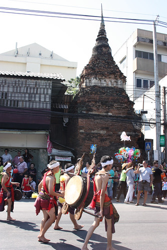 Chiang Mai Flower Festival Parade passes a Wat